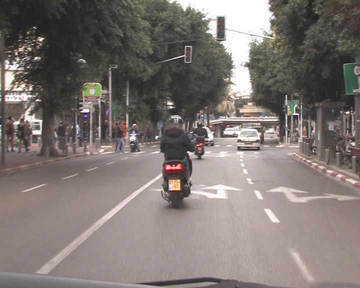 קטנוע אופנוע צילום אור ירוק