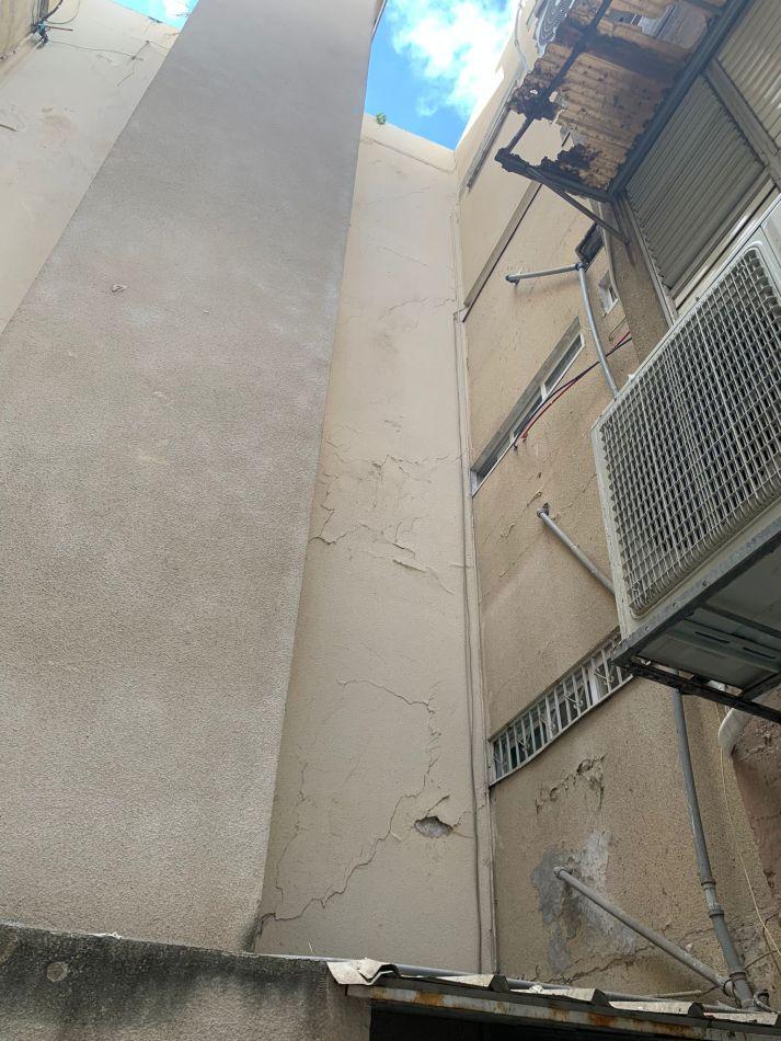 בניין הרוס קריסה צילום דוברות כבאות והצלה